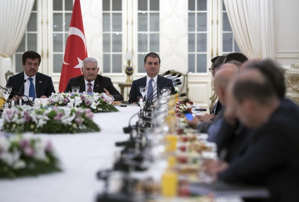 Economy Minister Nihat Zeybekci (L), Prime Minister Binali Yu0131ldu0131ru0131m (C) and EU Affairs Minister u00d6mer u00c7elik meet with German executives with investments in Turkey, u00c7ankaya Palace, Ankara.