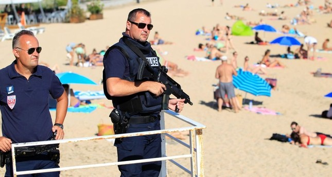 French police patrol a beach in Ajaccio on the French Mediterranean island of Corsica, Aug. 1.