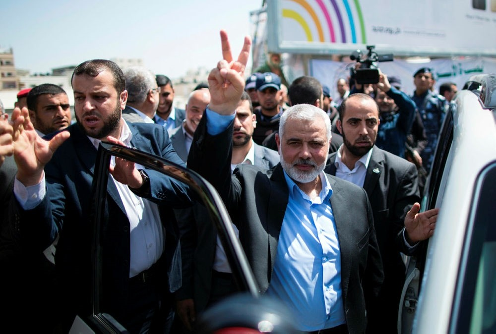 Newly elected Hamas chief, Ismail Haniya, flashes the V-sign after attending a rally in support of Palestinian hunger-striking prisoners held in Israeli jails. (AFP Photo)