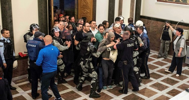 Policemen try to contain protesters trying to enter Macedonia's parliament in Skopje, on April 27. (AFP Photo)
