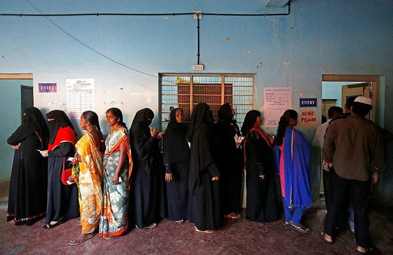 Voters wait in a queue to cast their ballot outside a polling station during Karnataka assembly elections in Bengaluru, India, May 12, 2018. (Reuters Photo)