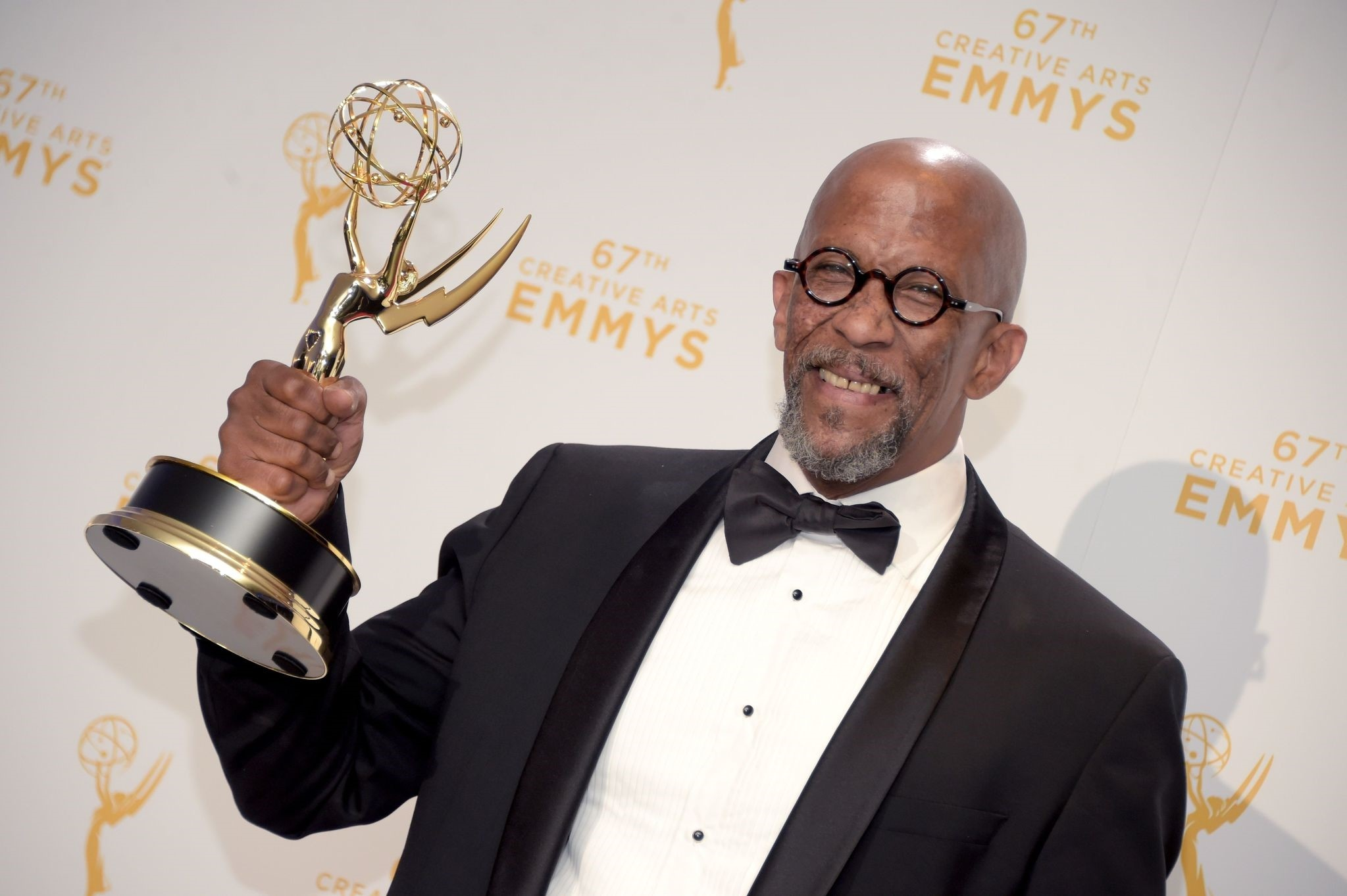 Reg E. Cathey, winner of the award for guest actor in a drama for ,House of Cards,, posing in the press room during the 2015 Creative Arts Emmy Awards at Microsoft Theater in Los Angeles, California. (AFP Photo)