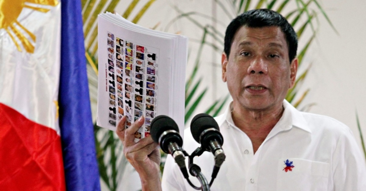 Duterte shows the list of government, military and police officials involved in illegal drug trade during a news conference in Davao city, Philippines October 27, 2016. (REUTERS Photo)