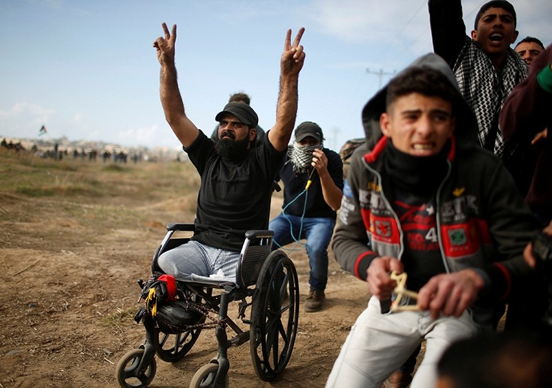 Wheelchair-bound Palestinian Ibraheem Abu Thuraya, who was killed by Israeli troops, gestures during a protest against U.S.' recognition of Jerusalem as Israel's capital, near the border with Israel in near Gaza City, Dec. 15, 2017. (Reuters Photo)