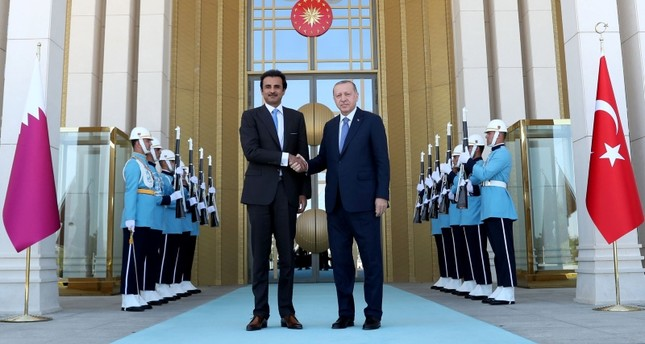 Turkey's President Recep Tayyip Erdogan (R) and the Emir of Qatar Sheikh Tamim bin Hamad Al-Thani shaking hands prior to their talks in Ankara.