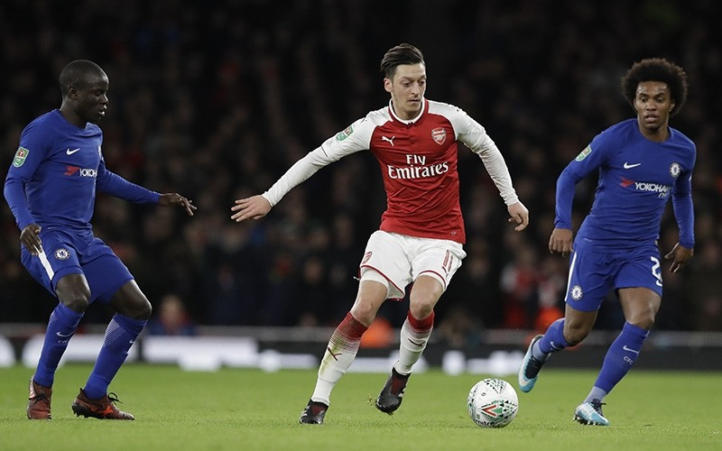 Arsenal's Mesut Ozil controls the ball during the English League Cup semifinal second leg soccer match between Chelsea and Arsenal at the Emirates stadium in London, Wednesday, Jan. 24, 2018. (AP Photo)