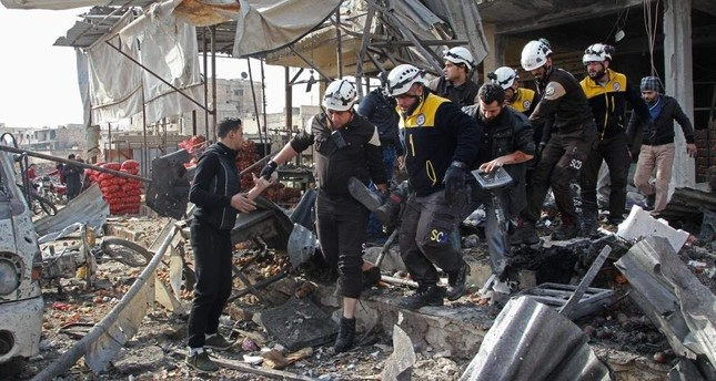 Members of the Syrian Civil Defense (White Helmets) recover a victim following a regime airstrike in a market in Idlib, Dec. 2, 2019. (AFP PHOTO)