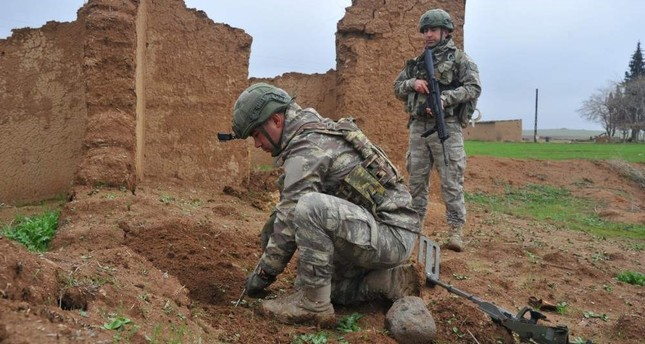 Turkish soldiers clear mines and explosives in northern Syria in this undated handout photo released by the Defense Ministry Defense Ministry Photo
