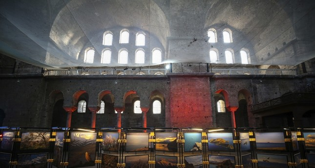 İzzet Keribar's photographs of the Akdamar Holy Cross Church are on display in the mesmerizing atmosphere of the Hagia Irene Church.
