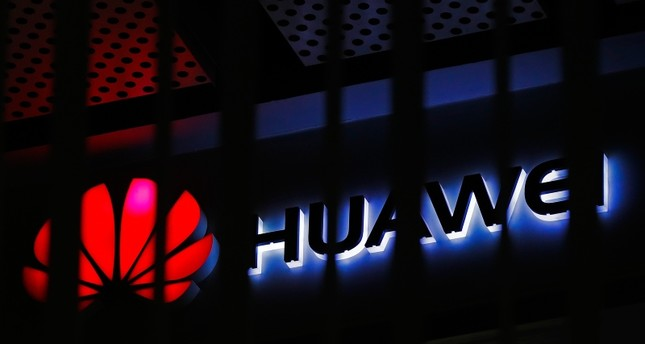 In this March 8, 2019, file photo, A logo of Huawei retail shop is seen through a handrail inside a commercial office building in Beijing. (AP Photo)