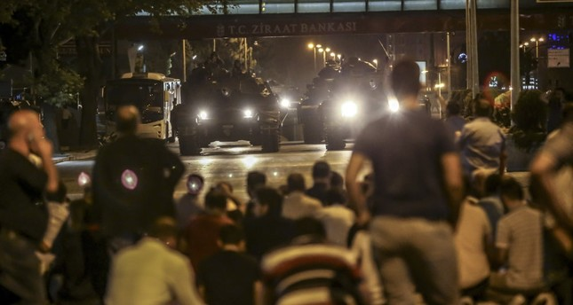 People confront tanks controlled by putschists in Ankara, July 15, 2016.