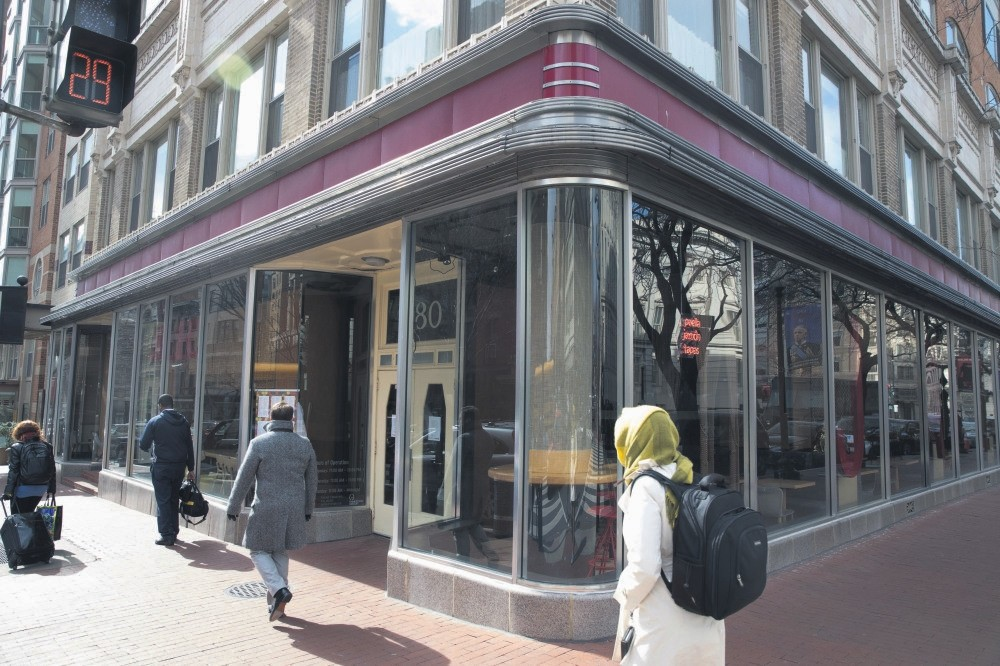 Pedestrians walk past the restaurant u2018Jaleo,' owned by chef Jose Andres, which is closed in solidarity with ,A Day Without Immigrants,, in Washington, DC.