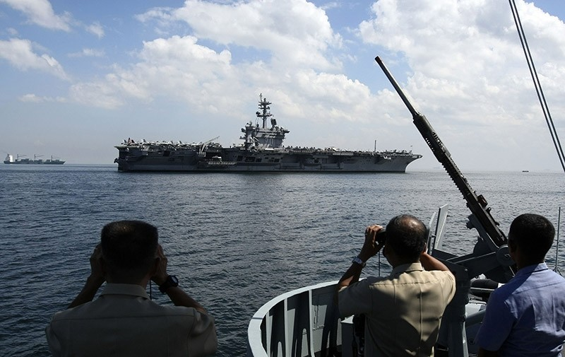Philippine Navy officers use binoculars to take a closer look at the U.S. aircraft carrier USS Carl Vinson. (Archive Photo)