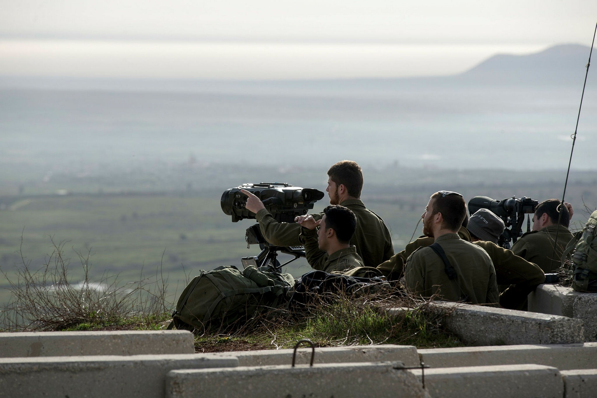 Israeli soldiers take positions next to the Israeli-Syrian border following the Israeli attack in Syria, Feb. 10.