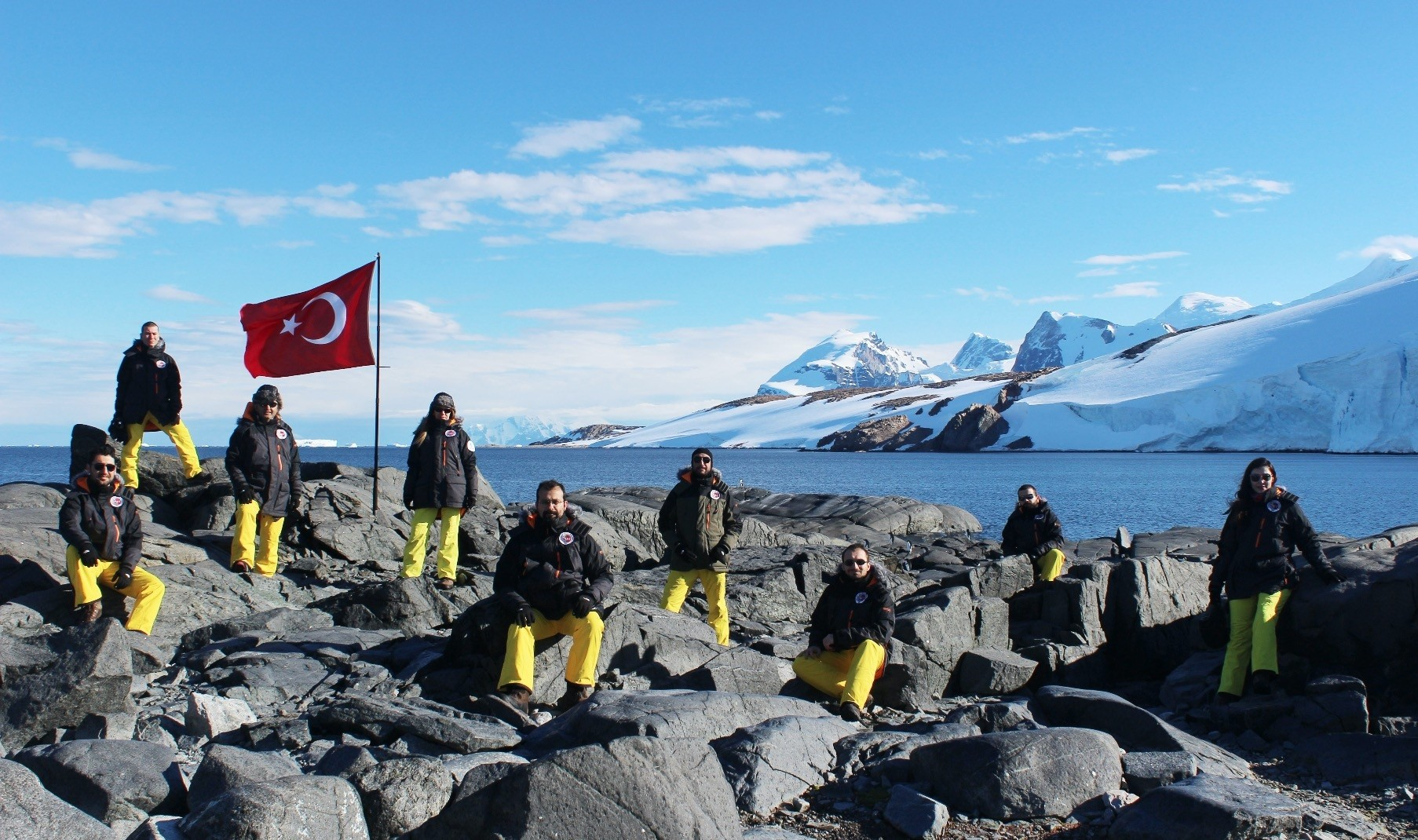 Scientists pose in front of a Turkish flag during an expedition in Antarctica last year.