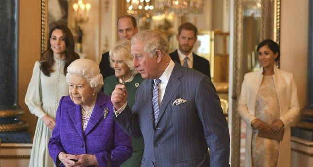 Britain's Queen Elizabeth II is joined by Prince Charles and at rear, from left, Kate, Duchess of Cambridge, Camilla, Duchess of Cornwall, Prince William, Prince Harry and Meghan, Duchess of Sussex, during a reception at Buckingham Palace, March 5, 2019. AP Photo