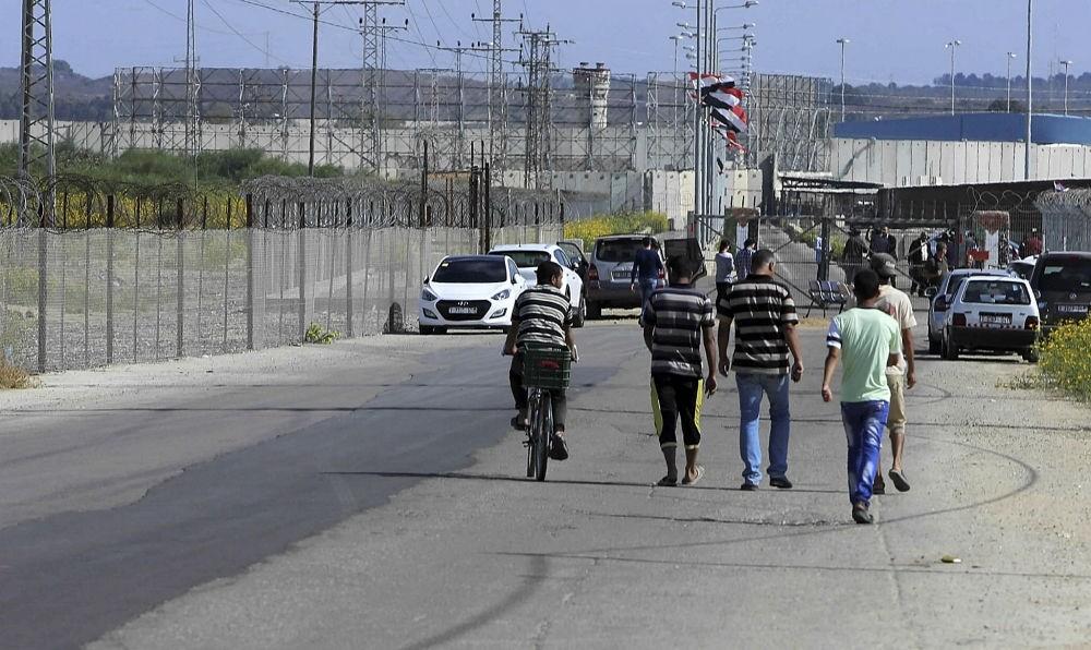 Residents walk toward the Palestinian side of the Erez checkpoint at Beit Hanoun, Gaza Strip, Nov. 1.