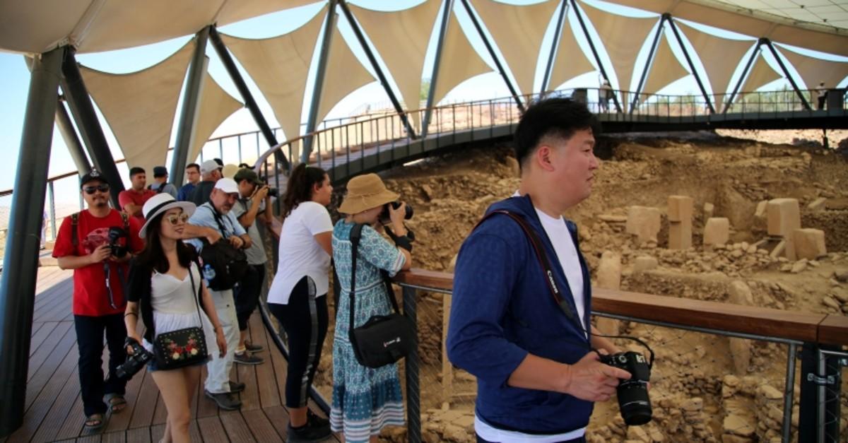 South Korean tourists visiting the ancient temple of Gu00f6beklitepe in Turkey's u015eanlu0131urfa province (AA File Photo)