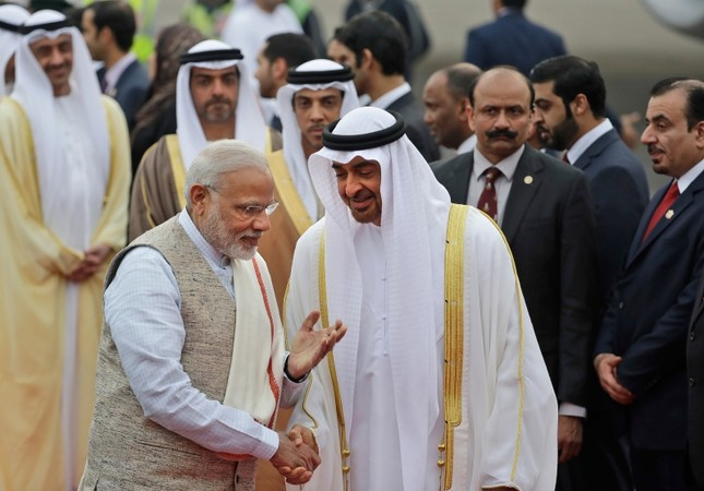 In this Jan. 24, 2017 file photo, Indian Prime Minister Narendra Modi, left, gestures as he receives Abu Dhabi's Crown Prince, Sheikh Mohammed bin Zayed Al Nahyan at the airport in New Delhi, India. (AP Photo)