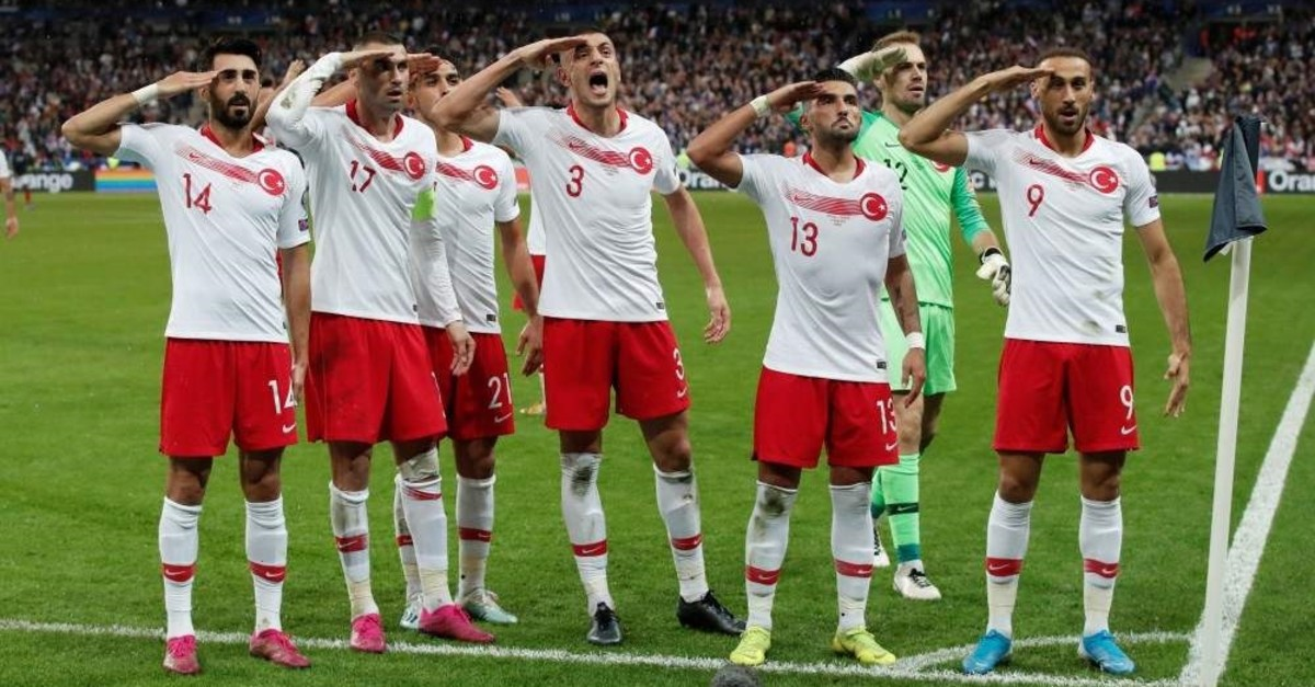 Turkish players salute after Kaan Ayhan scores first goal in a Euro 2020 qualifier against France, Saint-Denis, Oct. 14, 2019. (REUTERS Photo)