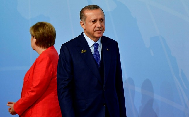 German Chancellor Angela Merkel (L) stands by President Recep Tayyip Erdoğan as he arrives to attend the G20 Summit in Hamburg, Germany, July 7.