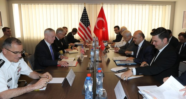 Defense Minister Fikri Işık (2nd R) with U.S. Secretary of Defense James Mattis (2nd L) at the NATO Defense Ministers Summit in Brussels, June 28.