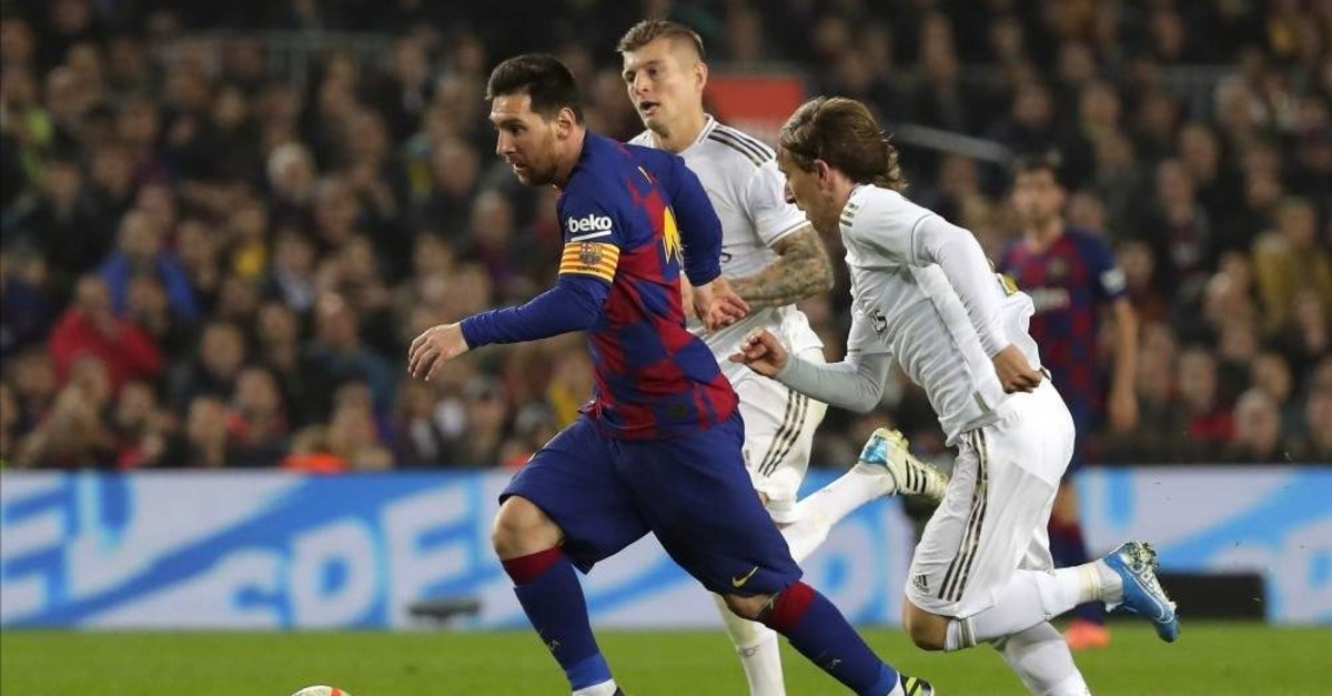 Messi vies for the ball with Modric during the ,El Clasico, in Barcelona, Dec. 18, 2019. (AP Photos)