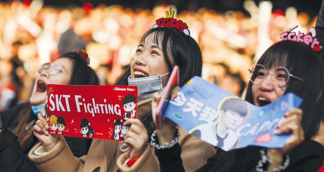 People watch the League of Legends 2017 World Championships Grand Final esports match between Samsung Galaxy and SK Telecom T1 in Beijing.