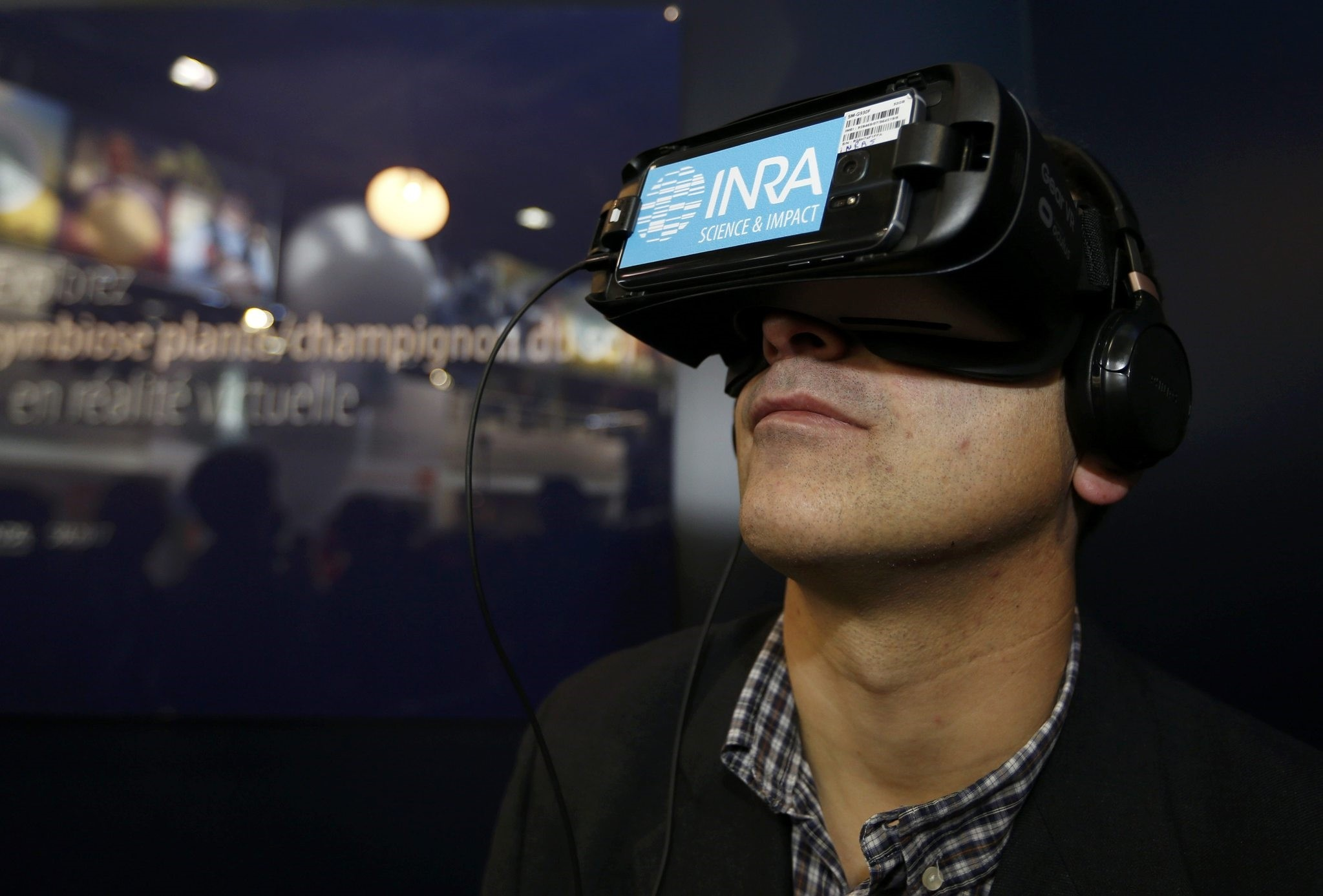 A visitor uses a virtual reality device with the INRA (National Institute for Agricultural Research) logo at the International Agricultural Show in Paris. (REUTERS Photo)