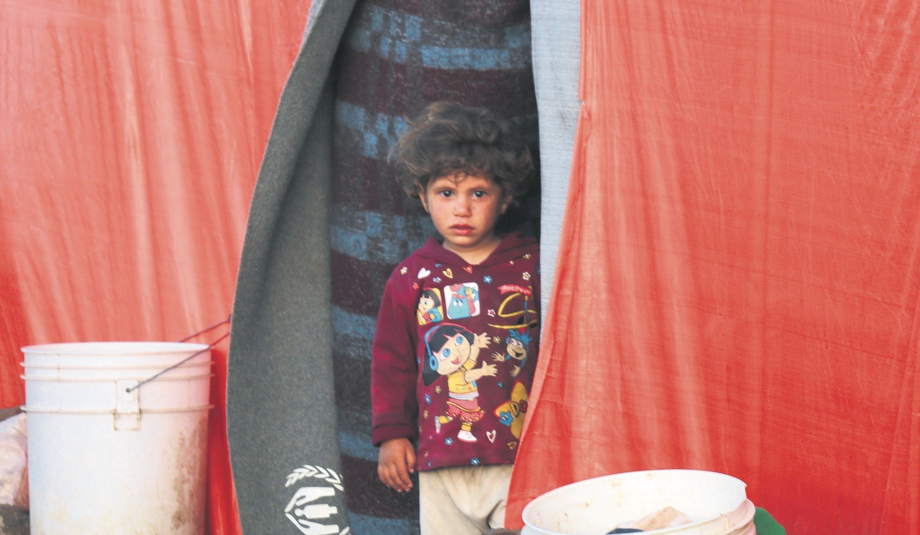A displaced Syrian child, from the province of Daraa, in a makeshift camp near the border between the Israeli-occupied Golan heights and Syria, July 3.