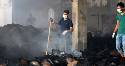 pPolice dogs discovered Thursday bone fragments believed to belong to a man that was caught in a yarn factory fire in southeastern Turkey's Gaziantep three days ago.br / br / The owner of the...