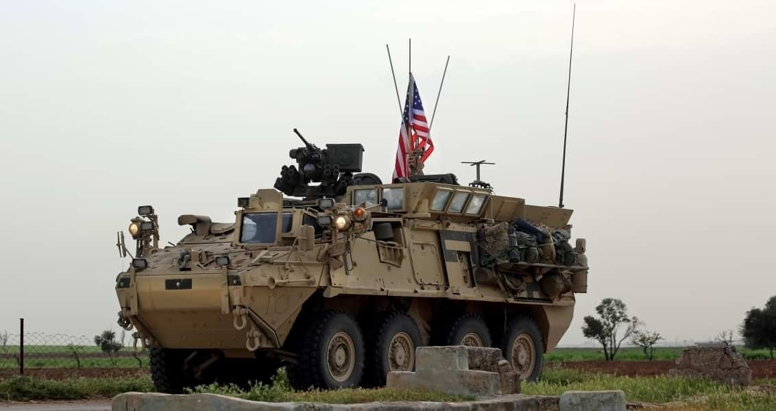 US forces, accompanied by YPG fighters, drive their armoured vehicles near the northern Syrian village of Darbasiyah, on the border with Turkey on April 28, 2017. (AFP Photo)
