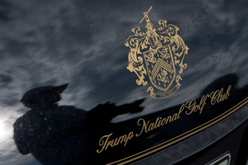 In this Tuesday, June 7, 2016 file photo, a photographer reflected in a golf cart at the the Trump National Golf Club Westchester in Briarcliff Manor, N.Y. (AP Photo)