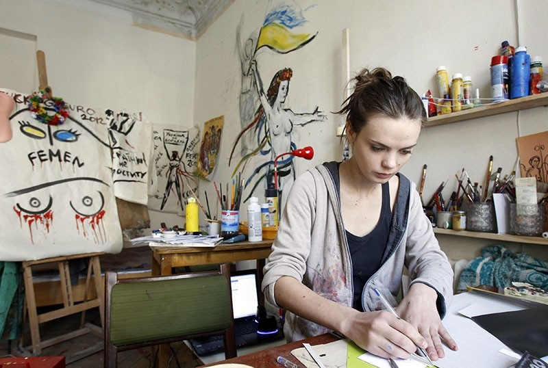 In this file photo from February 21, 2012, Femen activist Oksana Shachko sits at table in her room in Kiev, Ukraine. (Reuters Photo)
