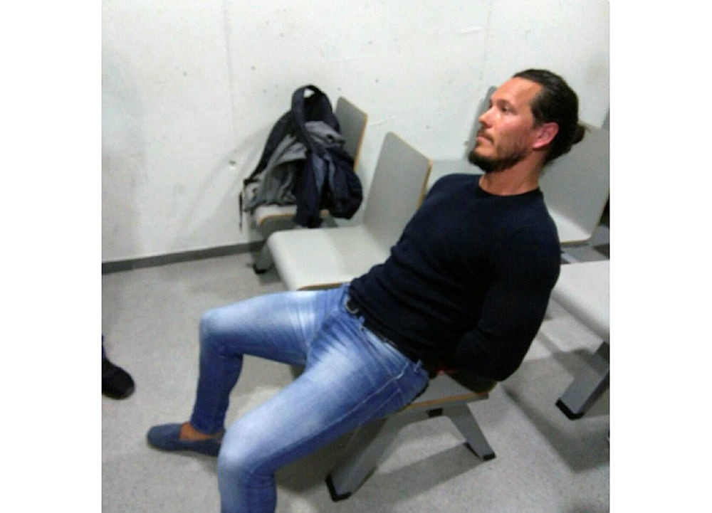 In this photo released May 5, 2018, by the UK National Crime Agency announcing the capture of one of Britain's most wanted fugitives Jamie Acourt, who was detained in Barcelona, Spain. (AP Photo)