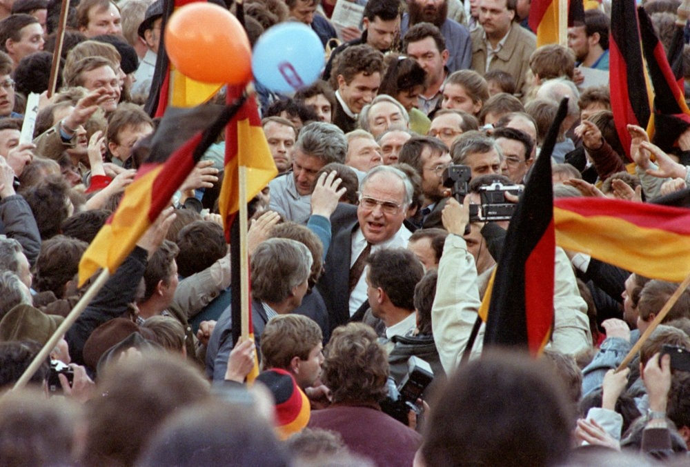 West German Chancellor Helmut Kohl moves through a crowd of supporters Feb. 20, 1990, during his first appearance as part of the East German election campaign in Erfurt, East Germany.