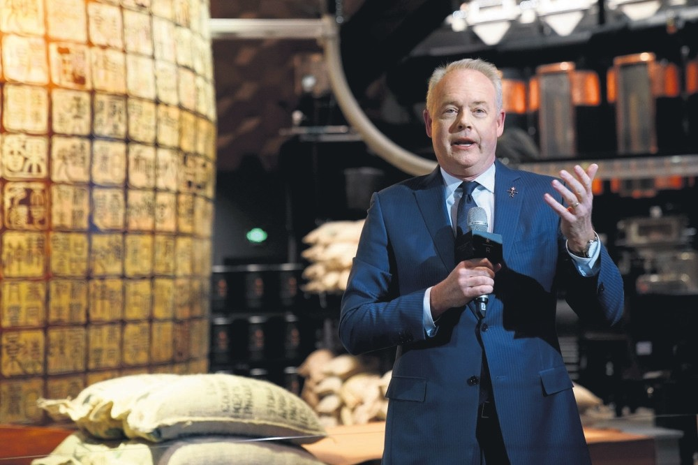 Starbucks CEO Kevin Johnson attends a press conference at the new Starbucks Reserve Roastery, Shanghai.