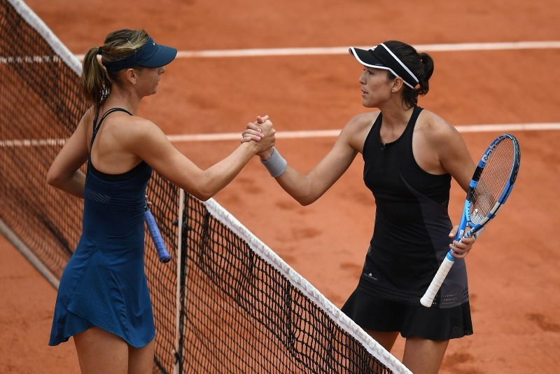 Spain's Garbine Muguruza (R) is congratulated by Russia's Maria Sharapova after winning, at the end of their women's singles quarter-final match on day eleven of The Roland Garros 2018 French Open. (AFP Photo)