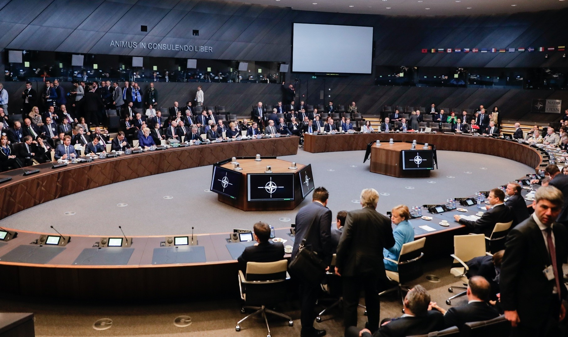 Heads of NATO member states and their delegations hold a working session during a summit at the NATO headquarters, Brussels, July 11.