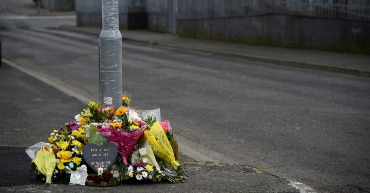 Flowers and a candle are left at the exact spot where 29-year-old journalist Lyra McKee was shot dead, in Londonderry, Northern Ireland April 20, 2019. (Reuters Photo)