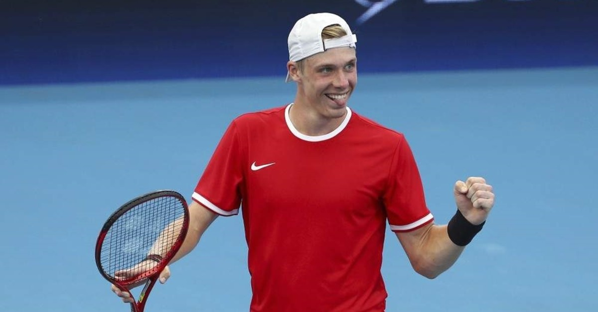 Canada's Denis Shapovalov reacts after he won his match against Stefanos Tsitsipas of Greece, Brisbane, Jan. 3, 2020. (AP Photo)