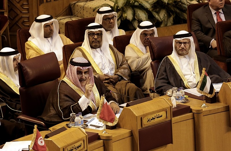 Bahraini Foreign Minister Khalid bin Ahmed al-Khalifa, left, speaks as Anwar Gargash, UAE Minister of State for Foreign Affairs, right, listens during a meeting at the Arab League headquarters in Cairo, Egypt, Sunday, Nov. 19, 2017. (AP Photo)