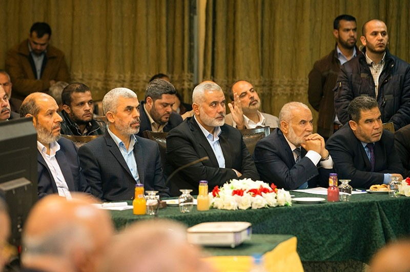 ahya Sinwar (C-L), the new leader of the Hamas movement in the Gaza Strip and senior political leader Ismail Haniyeh (C) attend a gathering to watch the speech of Exiled Hamas Chief, in Gaza City (AFP Photo)