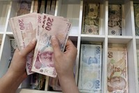 Turkish lira hits one-month high against US dollar