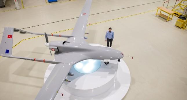 Baykar Chief Technology Officer Selçuk Bayraktar poses next to the Bayraktar Tactical Block 2 (TB2), a domestically-produced unmanned aerial vehicle (UAV) on Sept 10, 2018. (Photo credit: Saffet Azak)