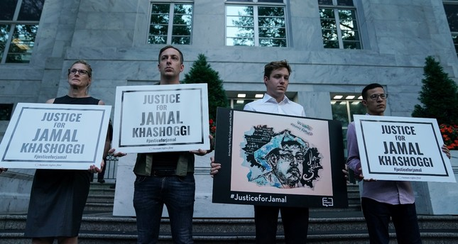 The Committee to Protect Journalists and other press freedom activists hold a candlelight vigil in front of the Saudi Embassy in Washington, U.S. to mark the anniversary of the killing of journalist Jamal Khashoggi, Oct. 2, 2019.