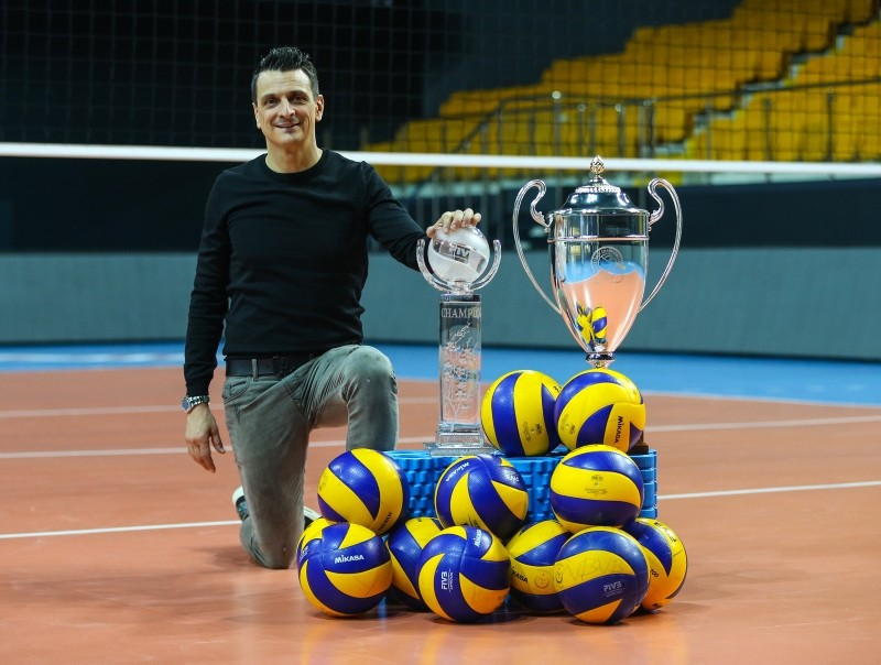 Giovanni Guidetti poses with his teamu2019s cups.