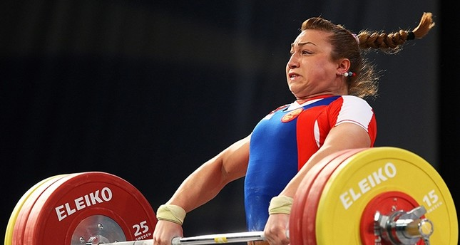 A file picture dated 10 April 2010 of Russia's Nadezhda Evstyukhina competing in the women's 75kg category during the European Weightlifting Championships in Minsk, Belarus EPA Photo