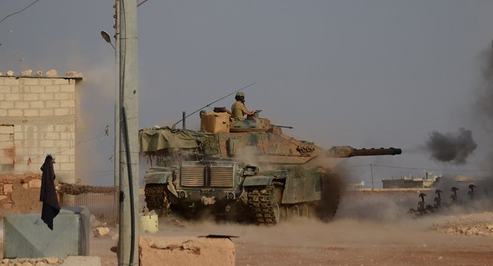 Turkish soldiers firing an upgraded M60 tank during fighting alongside members of the FSA against Daesh near the northern Syrian village of Beraan, northern Aleppo on Oct. 24, 2016.