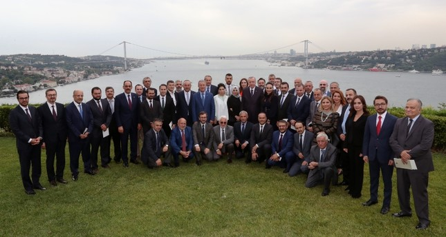 President Recep Tayyip Erdoğan poses for a photo with Presidency officials, media executives and academics at the Vahdettin Mansion overlooking Bosporus, on July 14, 2019. (AA Photo)